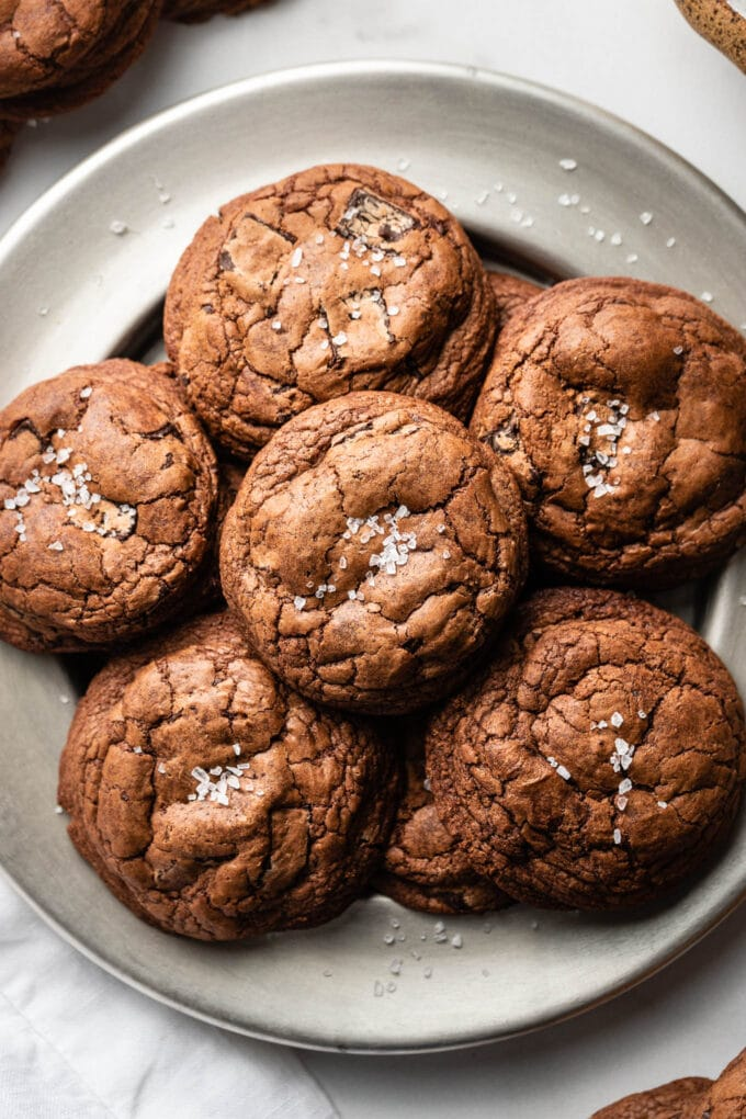 Small plate filled with salted double chocolate chunk cookies.