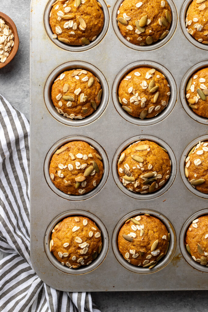 Just-baked pumpkin muffins, still in their tin.