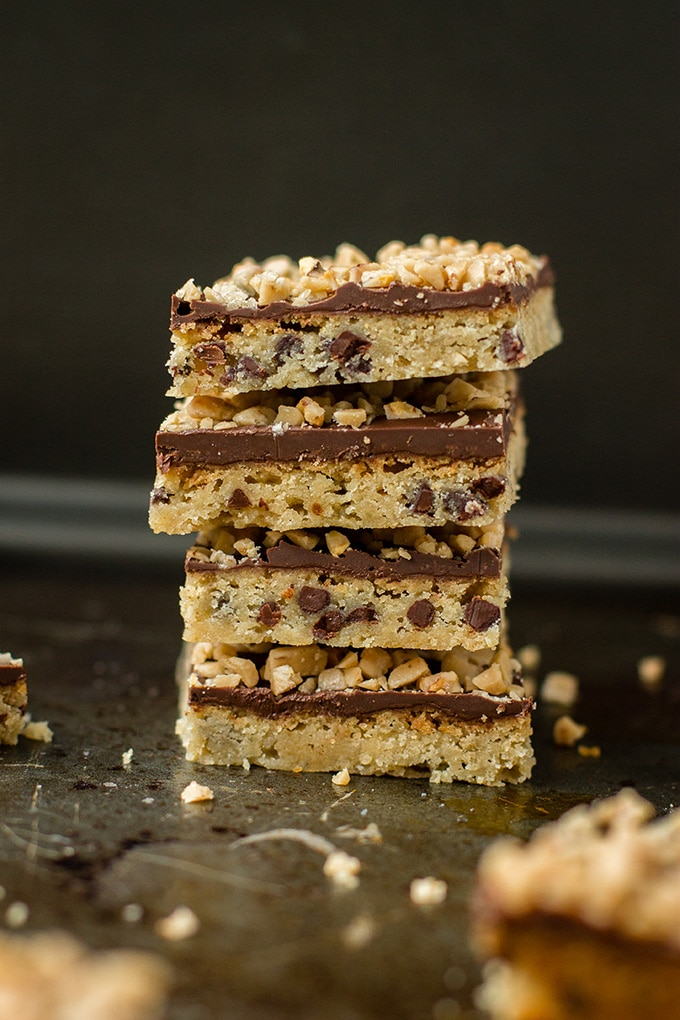 Layers of chocolate chip shortbread, spread with melted chocolate, and topped with toffee bits.