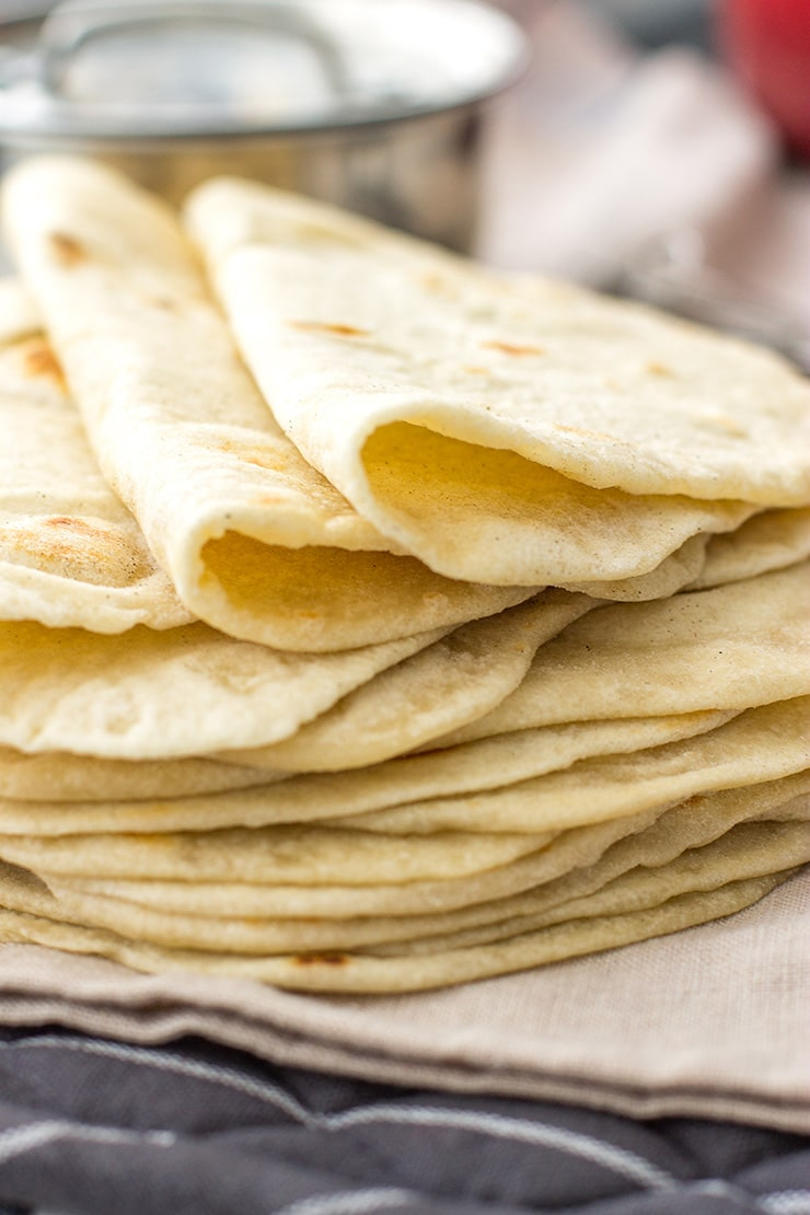 A stack of flour tortillas made from scratch.