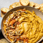 Savory sage pumpkin hummus is a MUST try! It's delicious AND healthy with this easy recipe, and so simple to make with basic ingredients in the blender or the food processor. It's also casually vegan and gluten-free. #pumpkinrecipes