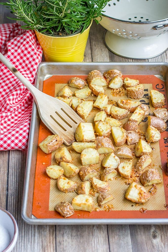 A baking sheet full of parmesan herb-crusted roasted red potatoes.