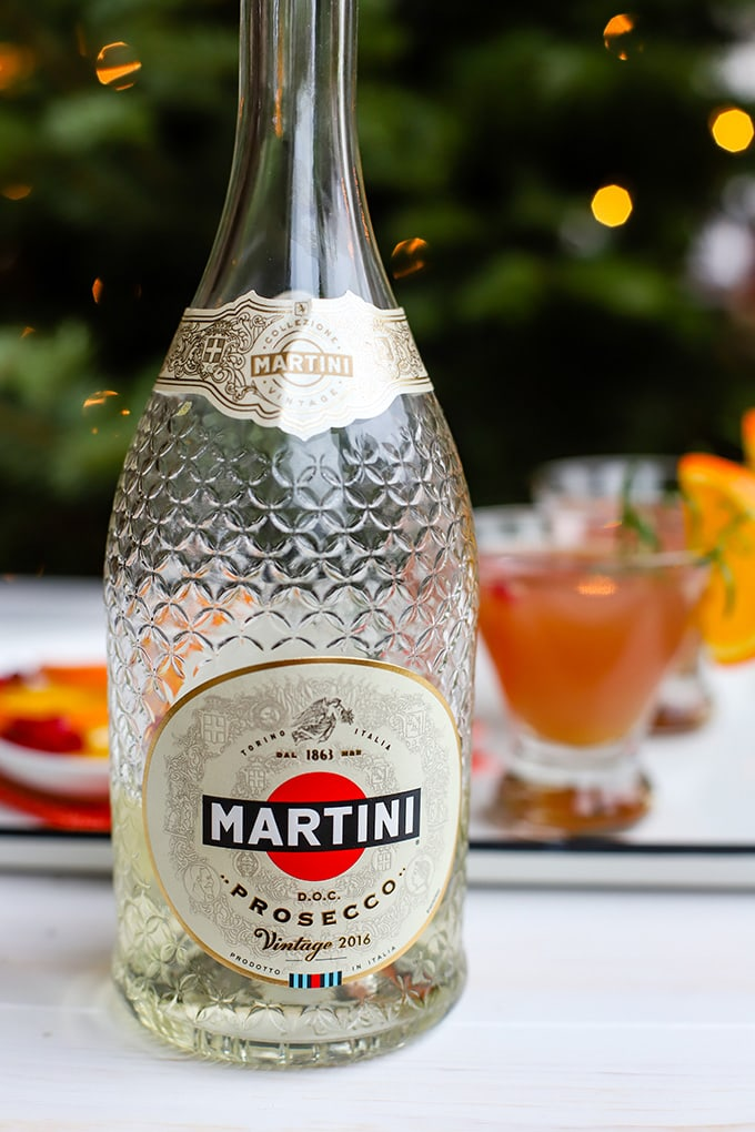 A bottle of Martini Rossi dry Prosecco.