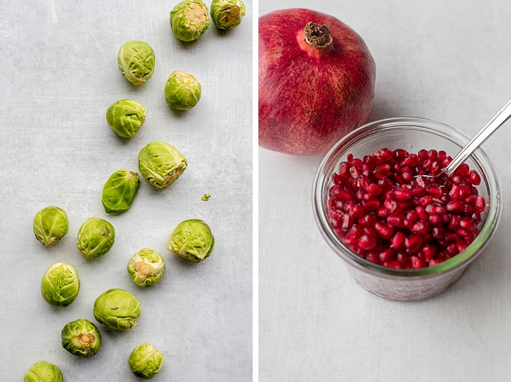 Whole brussels sprouts and a large jar filled with pomegranate arils.