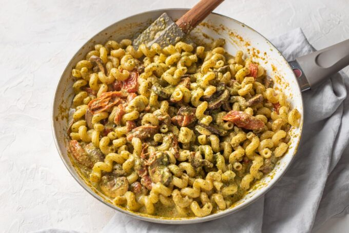 Pan filled with homemade pesto cavatappi, ready to serve.