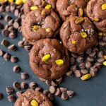 A pile of sea salt pistachio chocolate chip cookies.