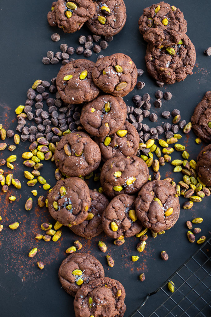 Flat-lay photo of sea salt pistachio chocolate chip cookies.