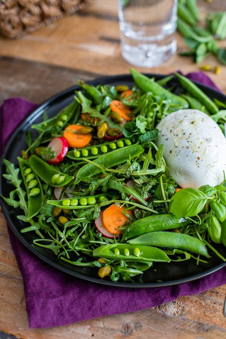 Spring sugar snap pea salad with arugula, carrots, radishes, mint, basil, and Buffalo mozzarella cheese.