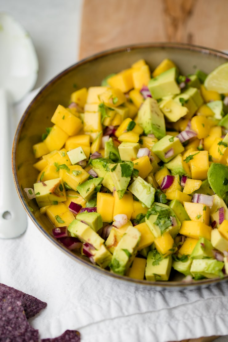 A large bowl full of fresh mango avocado salsa.
