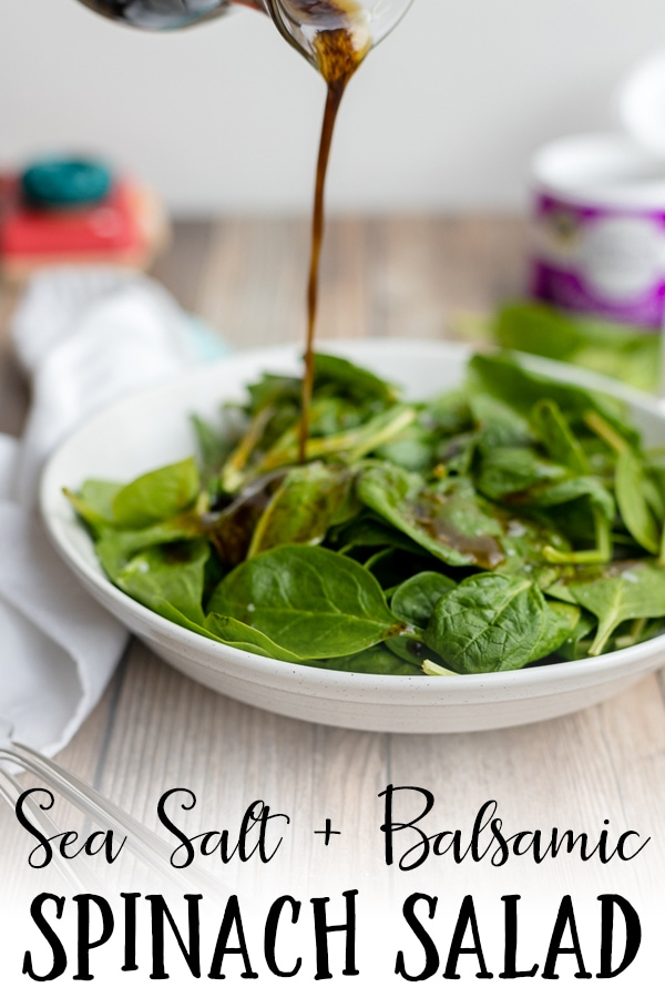 A light, easy side salad recipe, this balsamic spinach salad with coarse sea salt is perfect for rounding out a busy weeknight menu. Ready in less than 5 minutes, including the time you'll need to make a simple, perfect homemade balsamic salad dressing. #spinachsalad #balsamicvinaigrette
