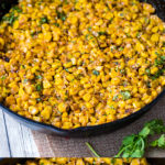 The ultimate skinny version of Mexican street corn dip, with charred sweet corn, the earthy heat of chipotle chilis, and tangy Greek yogurt! Easy to make and perfect for summer parties, game day snacking, and more! #streetcorn #texmex #summerrecipes