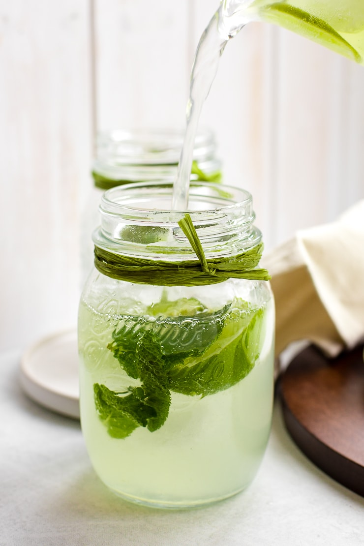 Two mason jars filled with sparkling limeade.