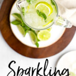 The ultimate summer drink recipe - sparkling limeade with simple syrup and mint! It's so fast and easy to make this non-alcoholic classic crowd-pleaser for your next summer gathering! #limeade #summerrecipes #drinks