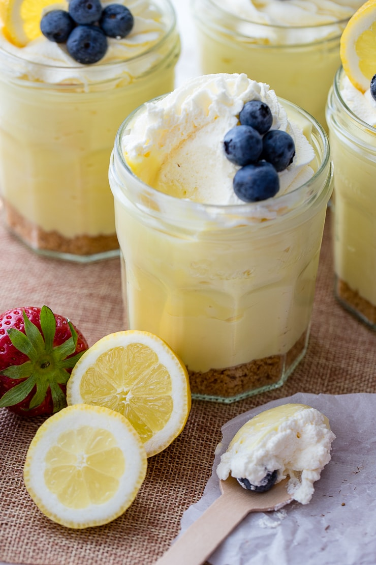 Jam jars filled with no-bake lemon cheesecake mousse.
