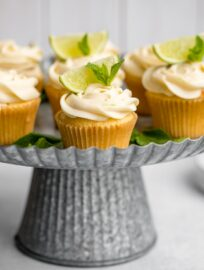 Spread of mojito cupcakes on a galvanized cake stand.