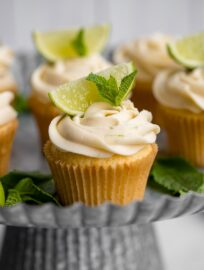 Close-up of a mojito cupcake on a galvanized cake platter.