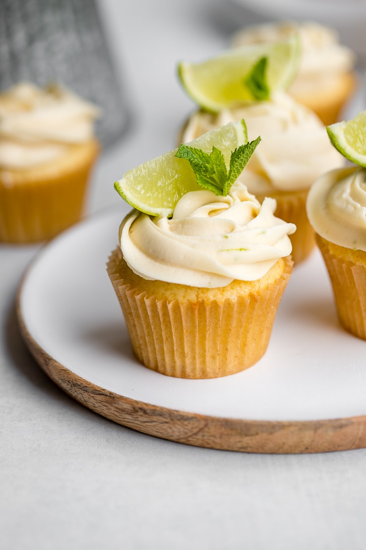Mojito cupcake on a white plate.