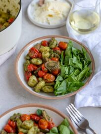 Close up of a bowl of gnocchi with pesto, ready to eat.