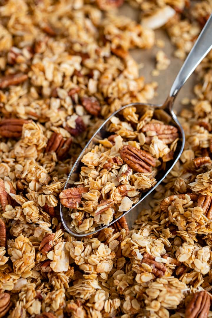 Close-up of a scoop of coconut pecan granola.