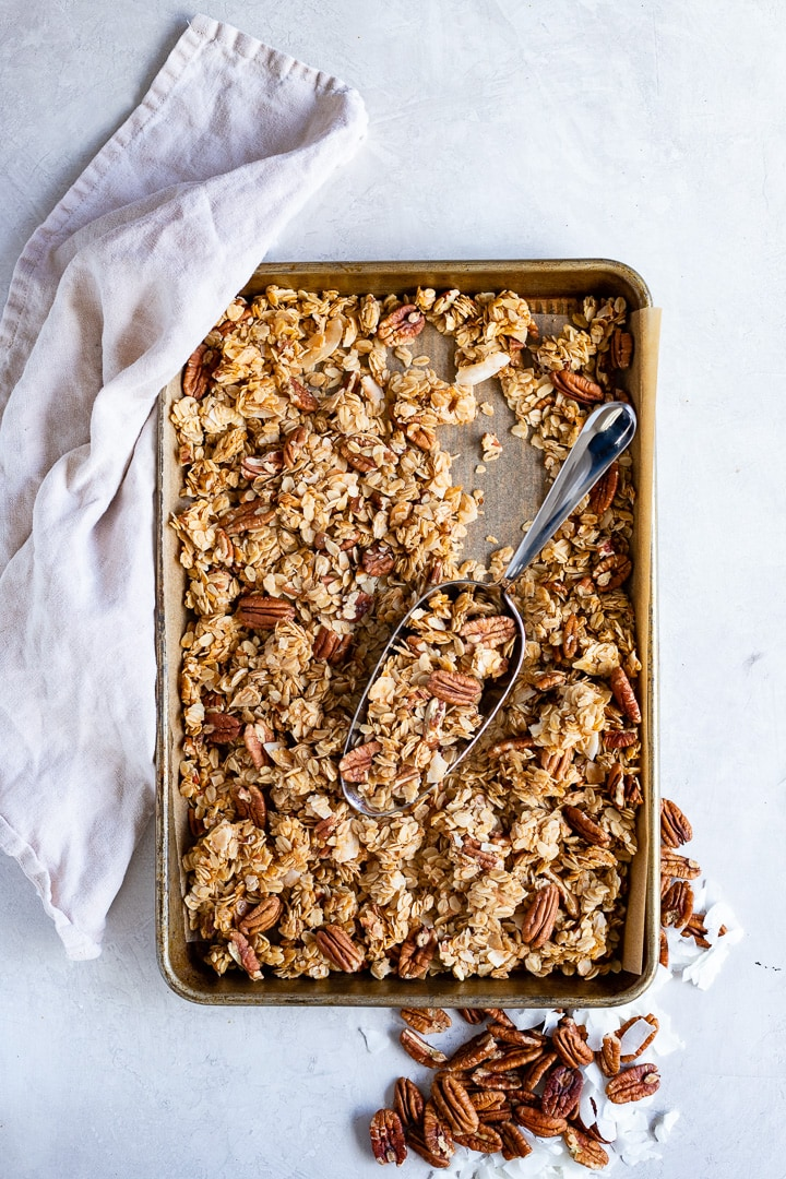 Baking tray filled with coconut pecan granola.