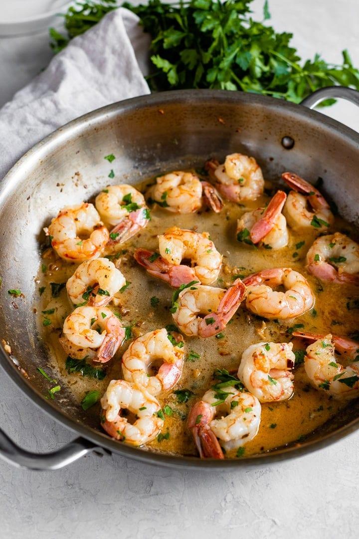 Skillet filled with garlic butter shrimp.