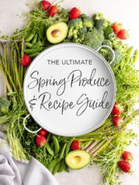 "White tray surrounded by produce, with letters ""The Ultimate Spring Produce and Recipe Guide"""