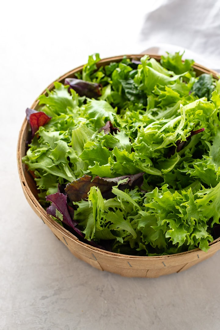 Close-up of lettuce leaves in a basket.