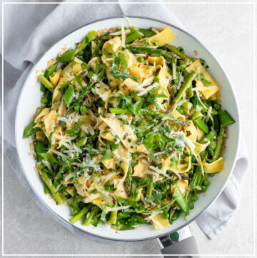 Skillet filled with creamy pasta Primavera.