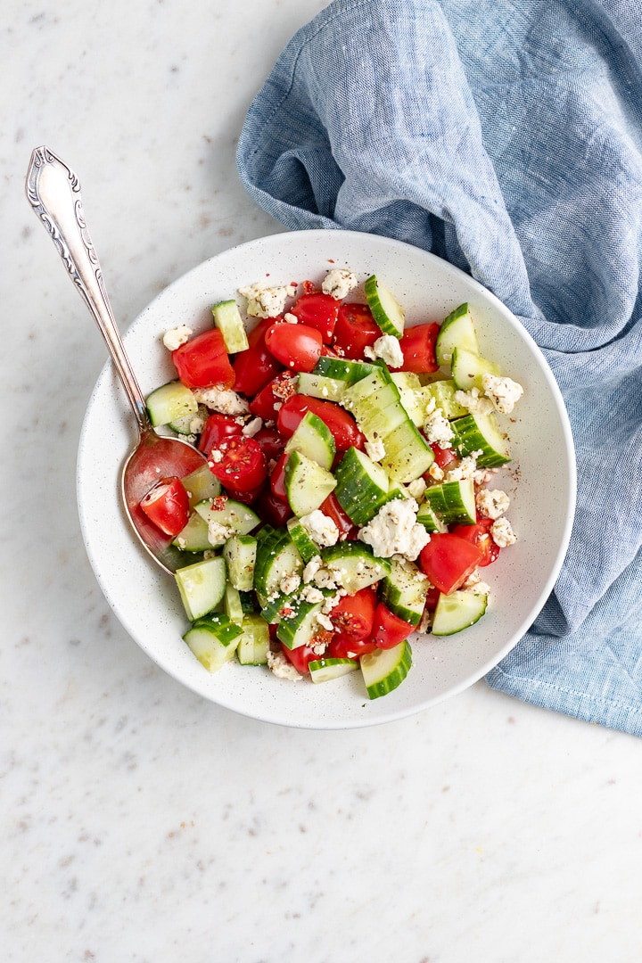 Photo of tomato cucumber salad with feta, ready to serve.