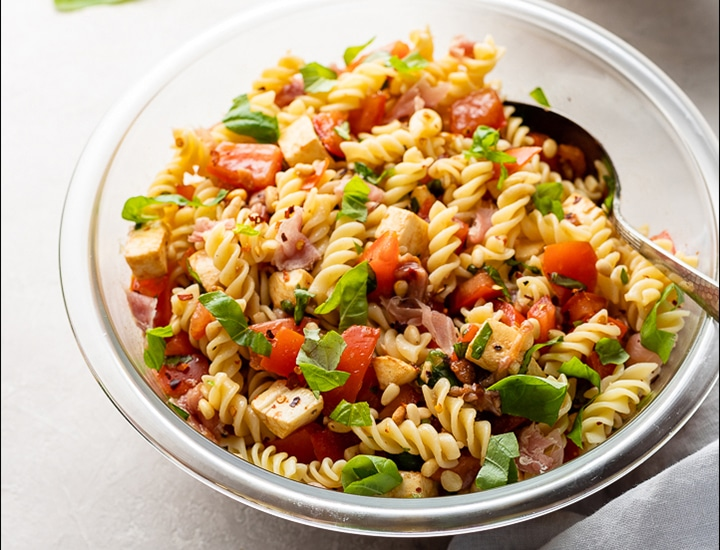 Finished dish of Caprese Pasta Salad.