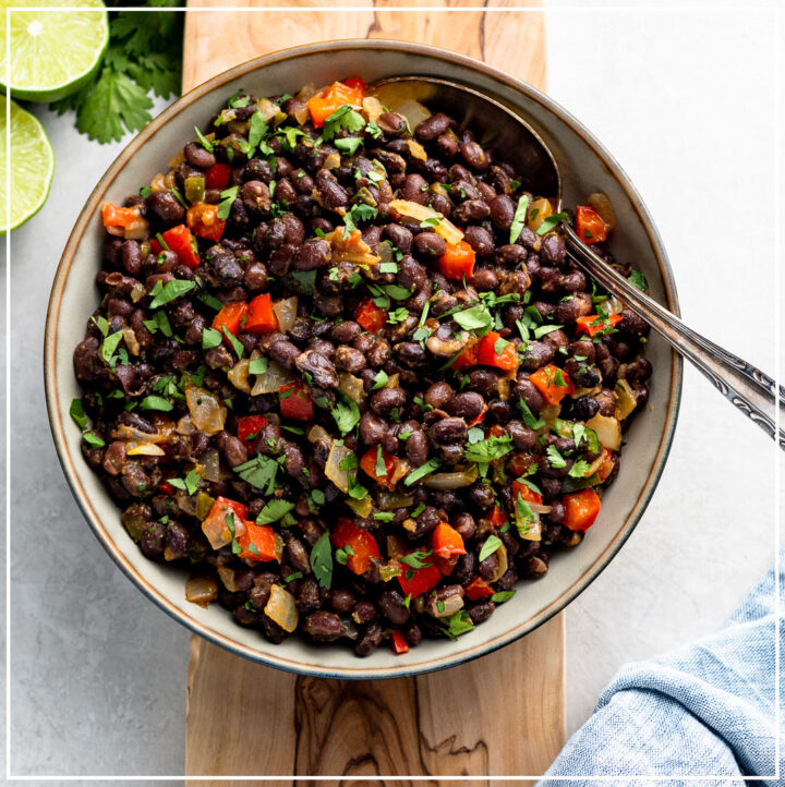 Bowl filled with spicy black beans ready to serve as a side dish.