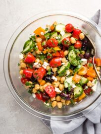 A large serving bowl filled with Greek chickpea salad.