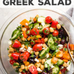 The BEST Greek Chickpea Salad with crunchy veg, tangy dressing, Kalamata olives, and creamy feta. We have this on constant repeat! I serve it at every barbecue and potluck, and love it for a meal prep lunch, too, with a little arugula and grilled chicken. SO GOOD. #greeksalad #mealprep