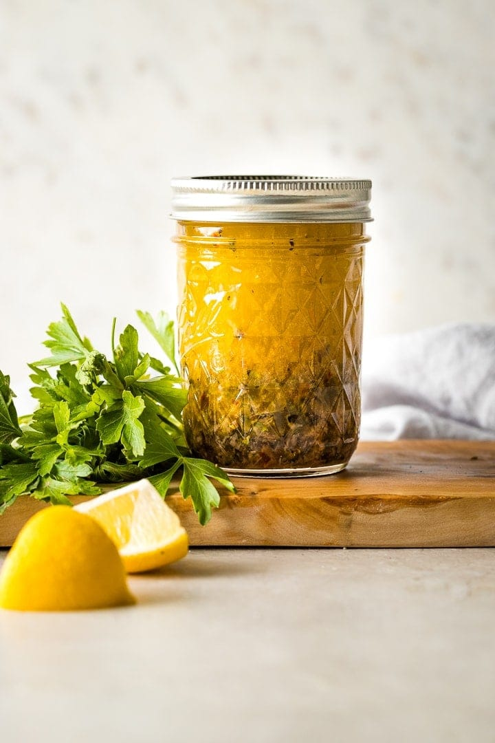 Jar of homemade Italian salad dressing.