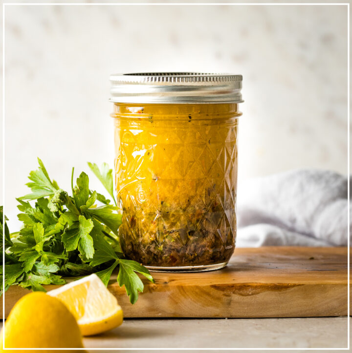 Jar of homemade Italian salad dressing.