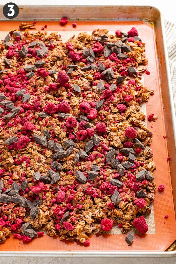 Raspberry chocolate granola, spread out to cool on a baking sheet.