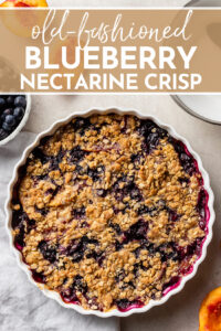 Grab all that fruit while it's still in season! This recipe shows you exactly how to make the best old-fashioned blueberry nectarine crisp, with a thick fruit filling and a warm, crackly, buttery oat topping. Grandma would be so proud! #fruitcrisp #summerdessert #blueberries #nectarines