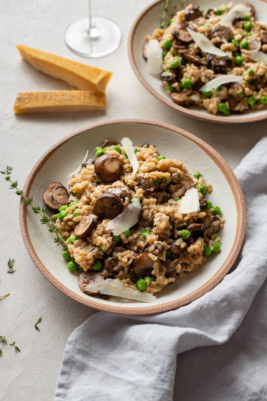A bowl of risotto cooked with mushrooms, peas, and Parmesan in the Instant Pot.