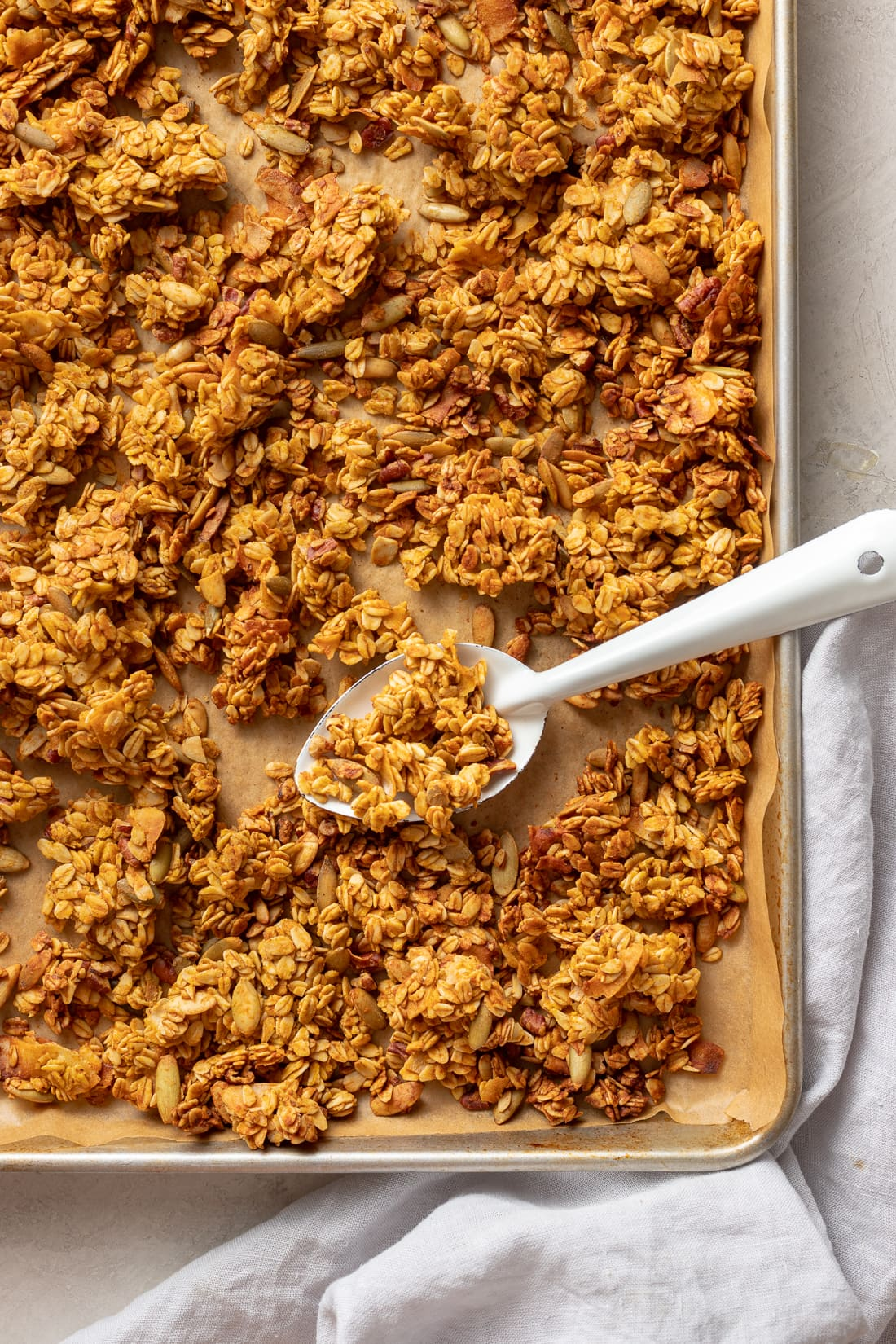 A large sheet pan full of toasty, just-baked pumpkin spice granola.