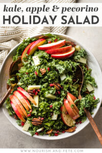 This is the best ever kale apple salad! Perfect for Thanksgiving, Christmas, or any holiday, with pecans, salty Pecorino cheese, and pomegranate seeds. It's healthy and easy to make, too, with a super simple 30-second salad dressing hack. #kalerecipes #saladrecipes