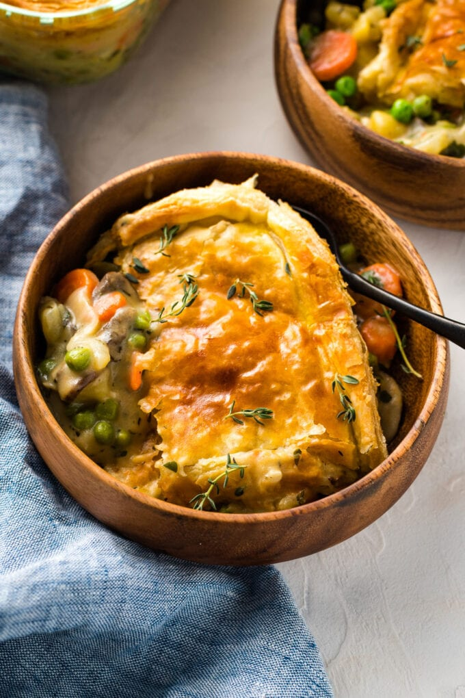 Bowls of vegetarian pot pie with a creamy roux, ready to eat.