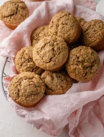 Banana bran muffins piled in a basket.
