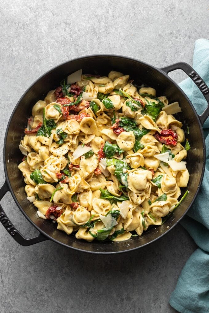 One pan creamy Tuscan tortellini with spinach and sun-dried tomatoes.