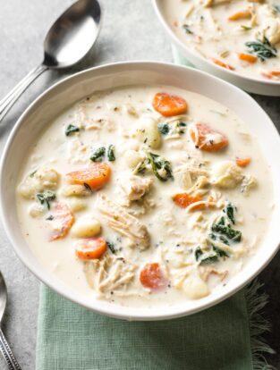 Bowls of creamy crockpot chicken gnocchi, a perfect Olive Garden copycat.