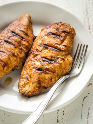 Juicy grilled chicken breasts seasoned with a homemade dry rub.