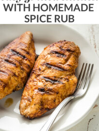 This easy grilled chicken uses a simple homemade dry rub to lock in incredible flavor with no fuss for the best BBQ chicken you've had in your life!
