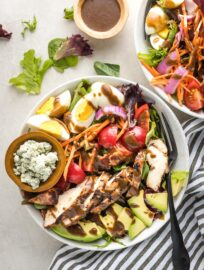 Overhead image of balsamic grilled chicken Cobb salad, served in a bowl for a large individual salad.