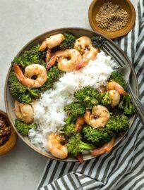 Bowl of white rice, broccoli, and honey garlic shrimp.